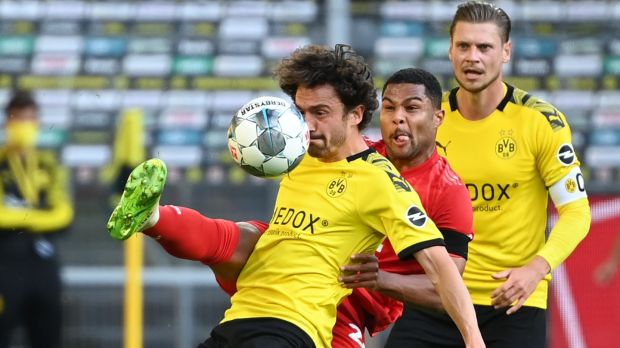 Serge Gnabry challenges Thomas Delaney during Bayern's narrow win over Dortmund. Photogrph: Federico Gambarini/Getty/AFP