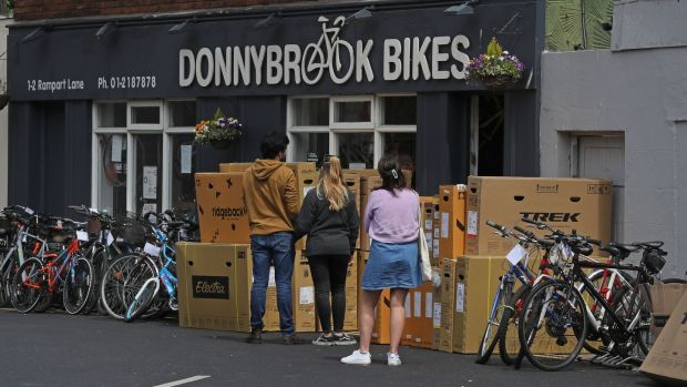 People queue among a delivery of new stock at Donnybrook Bikes. Photograph: Nick Bradshaw/The Irish Times.