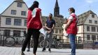 Mediators from the Strasbourg City Hall talk to people in the street about the prevention of coronavirus. Photo: Frederick Florin/AFP via Getty Images