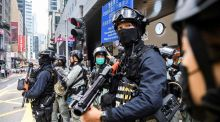 Riot police take part in a crowd dispersal operation in Hong Kong on Wednesday.  Photograph: Anthony Wallace/AFP via Getty Images