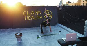 Séamus Keane holding an exercise class on his roof in Manhattan.