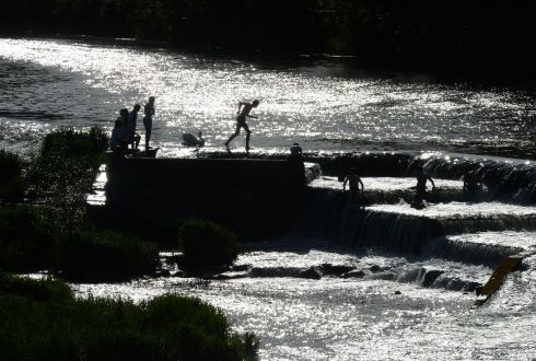 SHIMMERING WATER: Swimmers at the weir on the river Liffey in Lucan, Co Dublin. Photograph: Alan Betson/The Irish Times