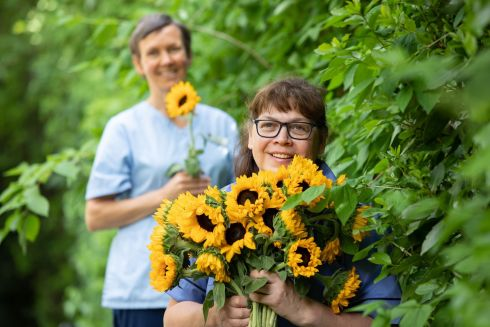 SHARE THE SUNSHINE: Martina Slattery, clinical nurse manager, and Karen Reid, senior staff nurse, both from Our Lady's Hospice & Care Services in Dublin, at the launch of this year's Hospice Sunflower Days collection. The annual fundraising event is taking place online this year. Photograph: Bryan Brophy/1IMAGE