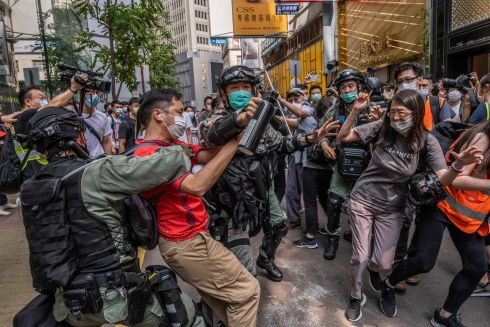 HONG KONG UNREST: Riot police officers clash with protesters in Hong Kong. Protests in the semi-autonomous city state swelled again this week after Beijing announced it would impose national security laws that democracy advocates fear would target dissent. Photograph: Lam Yik Fei/New York Times