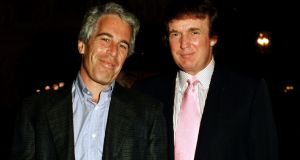Jeffrey Epstein and  Donald Trump as at the Mar-a-Lago estate, Palm Beach, Florida, in 1997. File photograph: Davidoff Studios/Getty Images