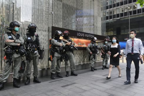 HONG KONG UNREST: Riot police stand in front of a Louis Vuitton luxury goods store, amid unrest in Hong Kong. Photograph: Roy Liu/Bloomberg