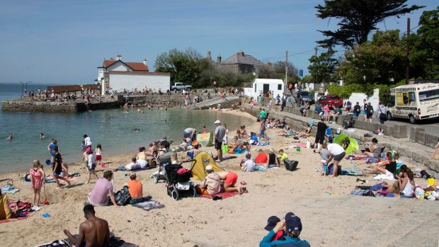 Sunbathers enjoying the fine weather at Sandycove on Thursday afternoon. Photograph: Colin Keegan, Collins Dublin