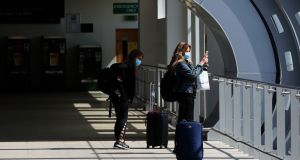 Passengers wearing protective face masks at Terminal 2 in Dublin Airport on Thursday. Photograph: Brian Lawless/PA Wire
