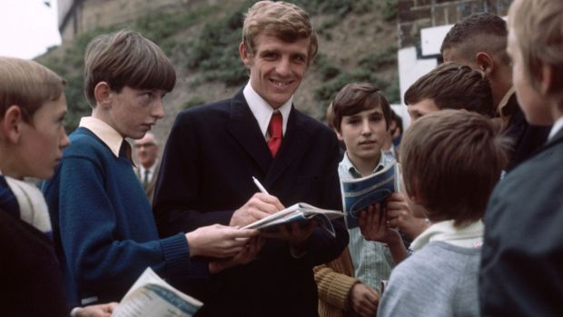 Eamon Dunphy signs autographs during his time with Millwall. Photograph: Express/Getty