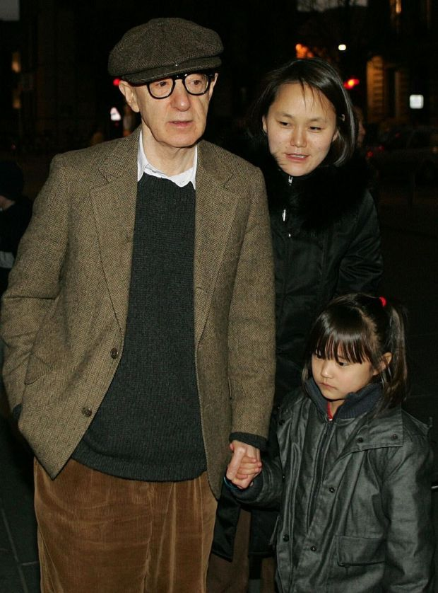 Woody Allen with his daughter Manzie and his wife Soon-Yi Previn in 2004. Photograph: Regis Duvignau/Reuters