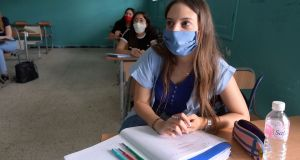 Officials are examining school reopening policies in other countries. Above, Tunisian school students wearing face masks in a classroom on May 28th, after authorities approved the easing of measures put in place due to the Covid-19 pandemic. Photograph: Fethi Belaid/AFP via Getty Images