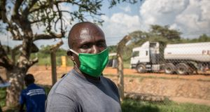 Truck driver Naliku Musa waits for coronavirus test results at the border between Uganda and South Sudan, which is closed to everything except cargo trucks. Photograph: Sally Hayden