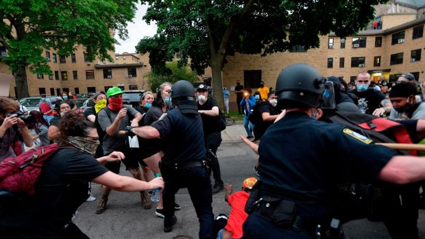 Police use batons as they clash with protesters outside the District Four Police station during a Black Lives Matter protest against police brutality and racism in the US in Boston, Massachusetts. Photograph: AFP via Getty Images