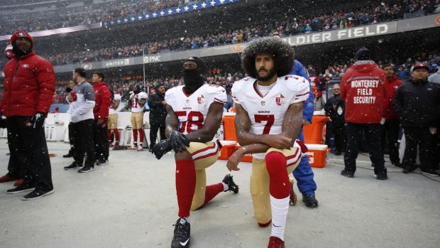 Eli Harold and Colin Kaepernick (right) of the San Francisco 49ers kneel on the sideline, during the national anthem, prior to the game against the Chicago Bears at Soldier Field on December 4th, 2016. Photo: Michael Zagaris/San Francisco 49ers/Getty Images