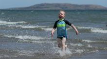 Four-year-old Cian Walshe plays in the sea off Portmarnock Beach, Dublin, on Friday. Liberated from work and the obligations of daily life, there is a sense of air and space. Photograph: Brian Lawless/PA Wire