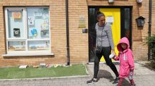 Ibti Gauthier and her son Adam (4), pass a Montessori and childcare facility in Dublin which is closed as a result of Government measures due to the Covid-19 pandemic. Photograph: Brian Lawless/PA Wire