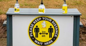 Hand sanitiser and a notice encouraging social distancing at Howth Golf Club in Dublin. Photograph: Paul Faith/AFP