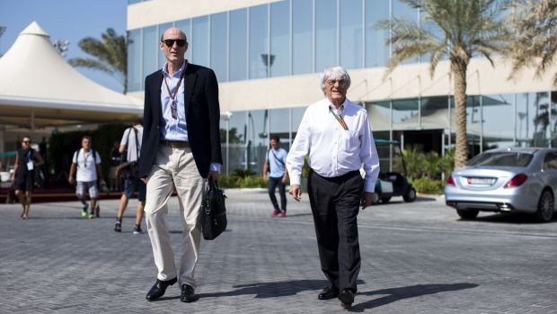 Bernie Ecclestone of Formula One with Donald MacKenzie of CVC Partners in Abu Dhabi in 2014. Photo: Peter J Fox/Getty Images
