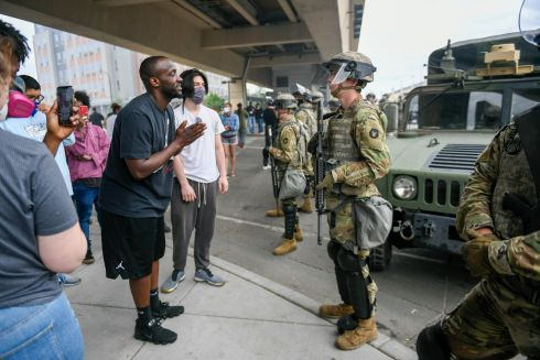 HEAR ME OUT: A protester speaks to a member of the Minnesota National Guard as confrontations continue in the wake of the death of George Floyd, a black man, in police custody, in Minneapolis, Minnesota, US. Photograph: Craig Lassig/EPA