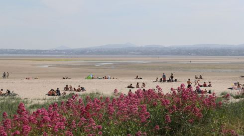 NO MIRAGE: Continuing fine weather over the June bank holiday weekend draws people to the beach, as seen at Irishtown Nature Reserve, Dublin. Photograph Nick Bradshaw