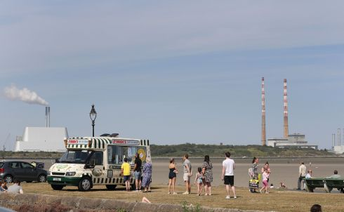 USELESS TO RESIST: Beachgoers queue for the ice cream van at Sandymount Strand in Dublin on yet another hot day. Photograph: Nick Bradshaw