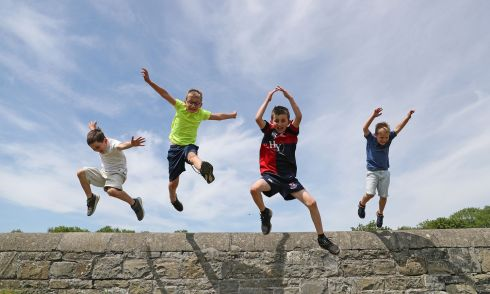 OFF THE WALL: Charlie (7), George (10), Matthew (9) and Sam Leyden (5), from Castleknock, enjoy the bank holiday weekend sunshine. Photograph Nick Bradshaw/The Irish Times