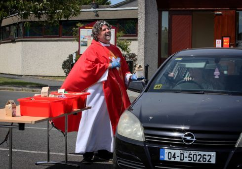 BOXED OFF: Parishioners return their Trócaire boxes to Fr Paul Thornton during a drive-thru for the purpose at St Cronan's, Brackenstown Parish, Swords. With schools and parishes closed, the charity has asked people to return their box donation online, over the phone, or if possible to their parish. Photograph: Mark Stedman