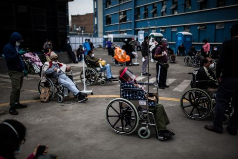 PERU PANDEMIC: People in wheelchairs wait in line to be seen, outside the Guillermo Almenara Hospital in Lima, Peru. The country has more than 155,000 cases of coronavirus, making it the second most affected country in Latin America after Brazil. Photograph: Sergi Rugrand/EPA