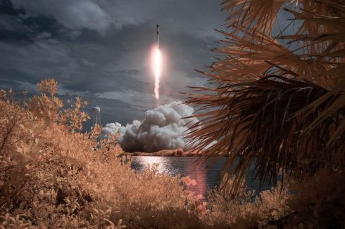 "OTHERWORLDLY: A SpaceX Falcon 9 rocket carrying the company's Crew Dragon spacecraft blasts off in this ""false colour infrared exposure"" photograph en route to the International Space Station, with astronauts Robert Behnken and Douglas Hurley aboard, at Nasa's Kennedy Space Center in Cape Canaveral, Florida. Photograph: Bill Ingalls/Nasa/AP"