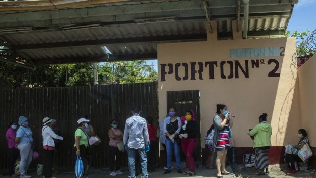 Relatives of coronavirus patients wait outside the German-Nicaraguan Hospital in Managua, Nicaragua on May 21st. Photograph: Inti Ocon/The New York Times