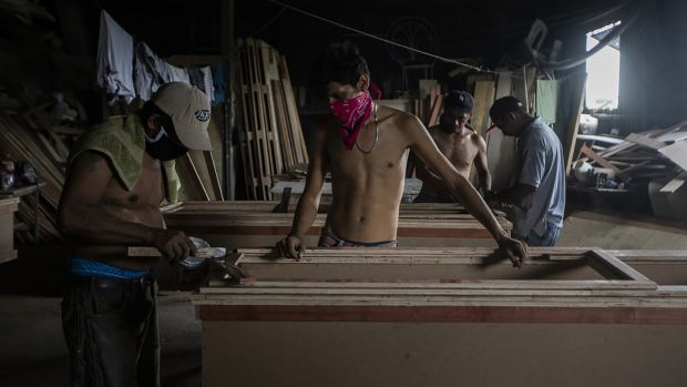 Workers at a funeral home make coffins in Managua, Nicaragua, on May 20th. Photograph: Inti Ocon/The New York Times