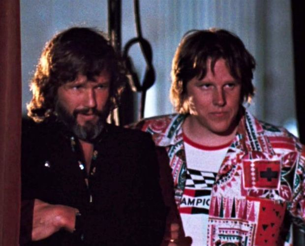 Gary Busey with Kris Kristofferson in the 1976 film version of a A Star Is Born