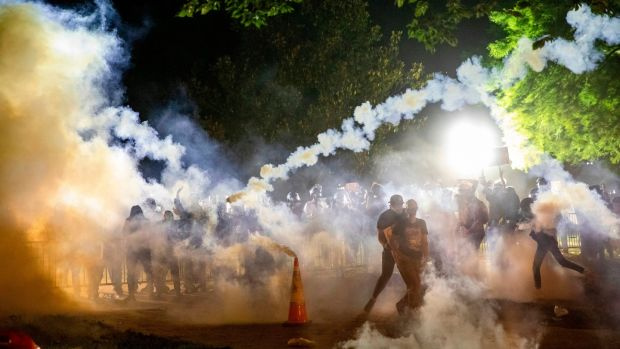 Tear gas rises as protesters face off with police during a demonstration outside the White House in Washington on Sunday. Photograph: Samuel Corum/AFP via Getty Images