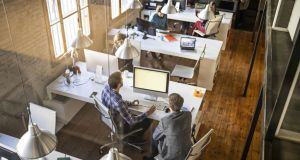 Implementing the rules could require employers to review how many people they can have in the office at a time. Photograph: iStock