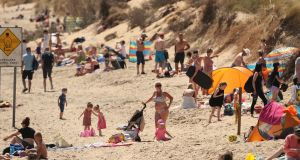 People enjoy the good weather at Brittas Bay beach, Co Wicklow, on bank holiday Monday. Gardaí have turned away non-locals who tried to visit. Photograph: Niall Carson/PA Wire