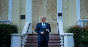 US president Donald Trump holds a Bible while visiting St John's Church across from the White House after the area was cleared of people protesting the death of George Floyd June 1st, 2020, in Washington, DC. Photograph: Brendan Smialowski/AFP