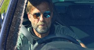 Liverpool manager Jurgen Klopp enters the club's training ground at Melwood. Photograph: Getty Images