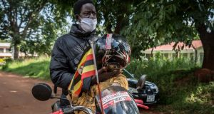 Ugandan activist Pat Robert Larubi is riding a motorbike across Uganda to deliver suncream to people with albinism. Photograph: Sally Hayden