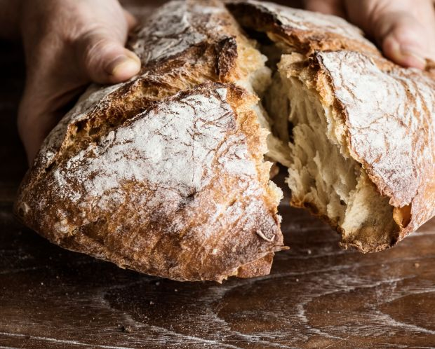 Tearing a bread loaf photography recipe idea. Photograph: iStock