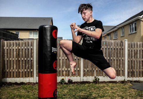 "PITY THE PUNCHBAG: Nate ""The Great"" Kelly, a teenage mixed martial arts fighter, training in Dublin. Photograph: Dan Sheridan/Inpho"