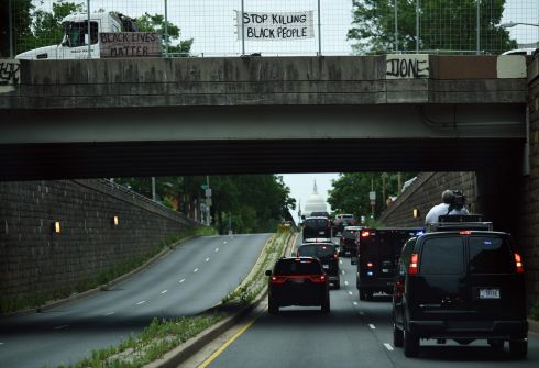 THE TRIALS OF TRUMP: Black Lives Matter posters hang from a bridge as US president Donald Trump's motorcade passes underneath, in Washington, DC. The president faced a wave of criticism over his handling of ongoing protests and violence in the wake of the police killing of a black man in Minneapolis last week. Photograph: Brendan Smialowski/AFP/Getty