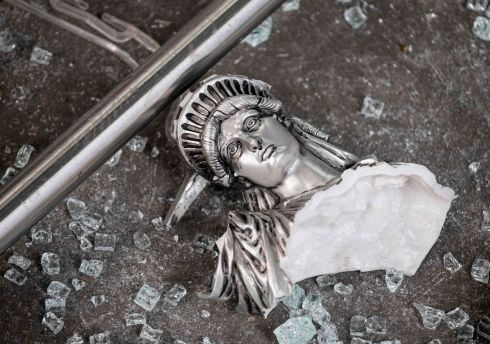 STATUE OF MISERY? A broken Statue of Liberty figurine lies amid shattered glass outside a looted souvenir shop after a night of violent protesting in the wake of the police killing of African-American man George Floyd, in Manhattan, New York City. Photograph: Johannes Eisele/AFP/Getty