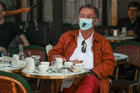HEALTHY OPTION: French photographer Pascal Rostaing smokes a cigar through a face mask at Cafe de Flore in the Latin Quarter district of Paris, France, as bars and restaurants reopen in the city amid the coronavirus pandemic. Photograph: Christophe Petit Tesson/EPA