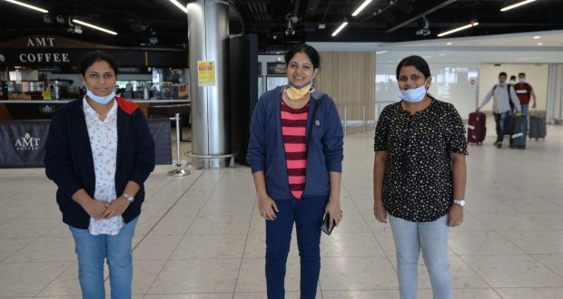 Princey Phillips, Jismey Jose and Teena Matthew who will be working in Nursing Home in Kildare, Dublin and Roscommon, some of over 50 health care professionals who arrived in to Dublin Airport on a flight from India. Photograph: Alan Betson / The Irish Times
