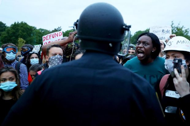 Protesters confront police in Boston. Photograph: Maddie Meyer/Getty