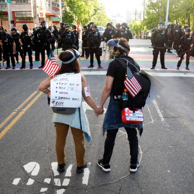 A couple stand together in Seattle on Monday. Photograph: Jason Redmond/AFP/Getty