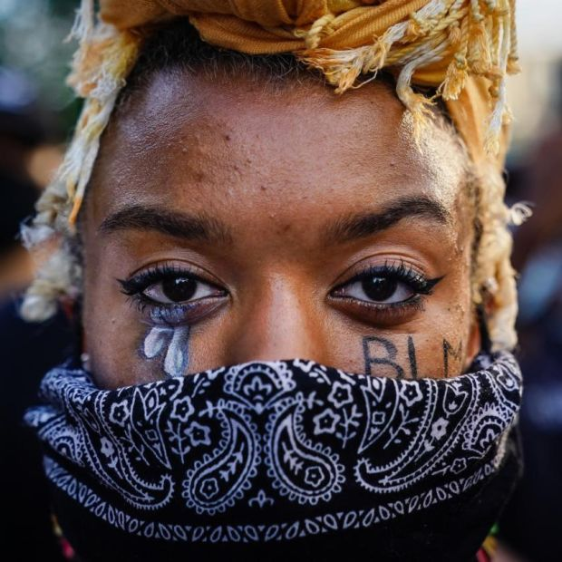 A protester in Atlanta, Georgia, on Sunday. Photograph: Elijah Nouvelage/Getty