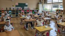 Children wearing plastic face visors in class at Kinugawa Elementary School in Nikko, Japan, on Wednesday. Schools that were in lockdown in Japan reopened this week. Photograph: Carl Court/Getty Images