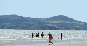 People on Portmarnock Beach, Dublin, last Friday. Photograph: Brian Lawless/PA Wire