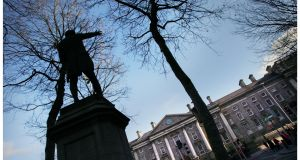 Trinity College with statue of henry Grattan in the foreground . Photograph: Bryan O'Brien
